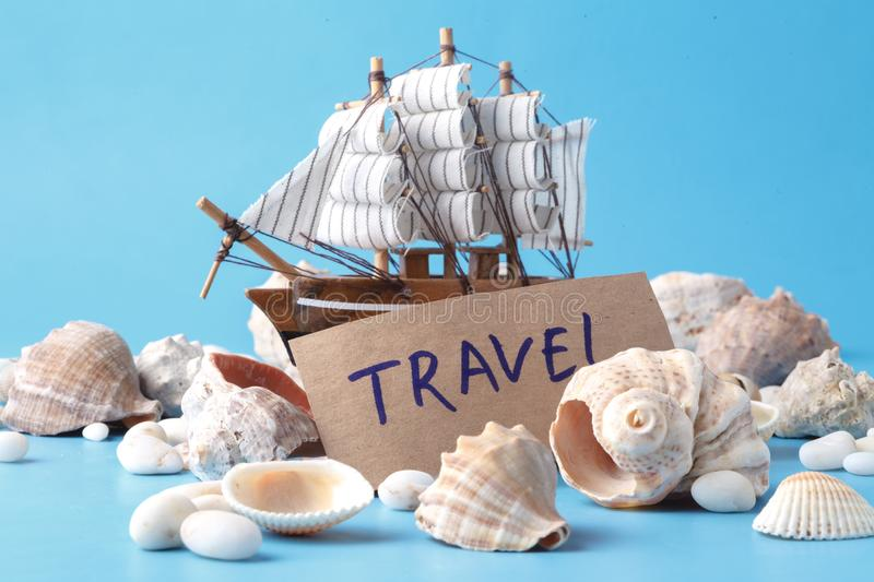 Sea travel in vacation concet with shell and ship stock photography
