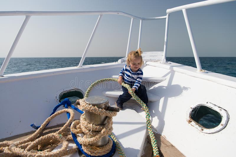 Sea trip concept. Small kid enjoy sea trip on boat. Boy sailor on sea trip. Sea trip and cruise. Let your dreams set stock photos