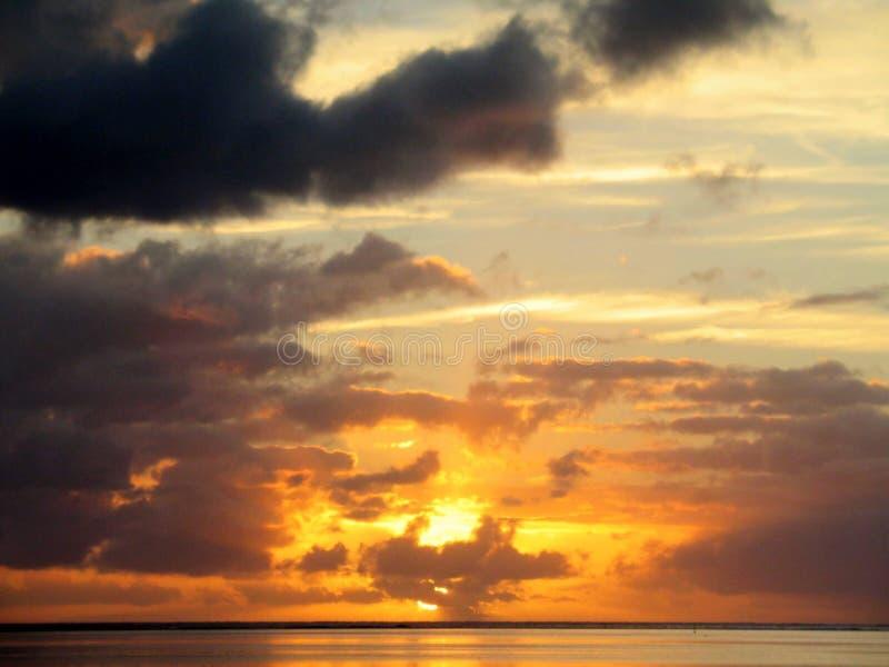 Sea under a cloudy sky at sunset in Tahiti. Bora  Bora. A sea under a cloudy sky at sunset in Tahiti. Bora  Bora royalty free stock images