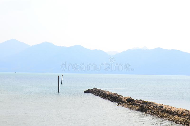 The sea is very calm with gentle ripples. Background of sky and sea stock images