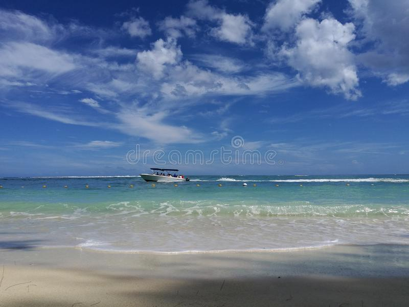Sea view from beach on passing by boat royalty free stock photos