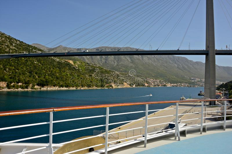 Sea view from the bow of cruise ship Costa Deliziosa of a modern bridge over the sea stock images