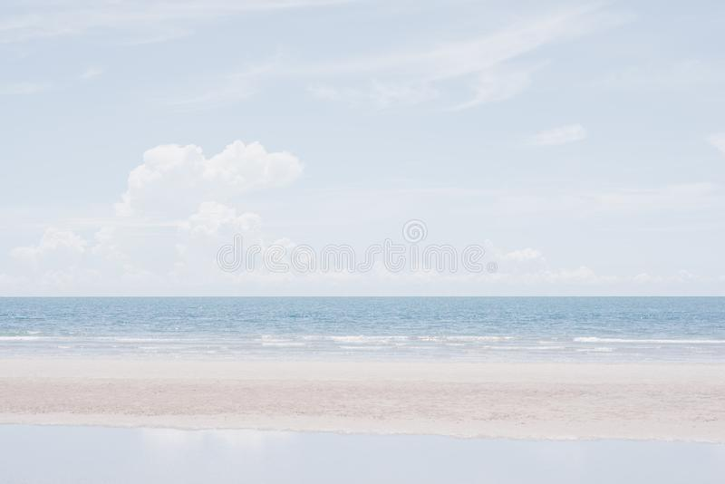 Summer background of pastel shades. Sea view with diverse cloud formations in the sky and the beach. Summer background of pastel shades royalty free stock images