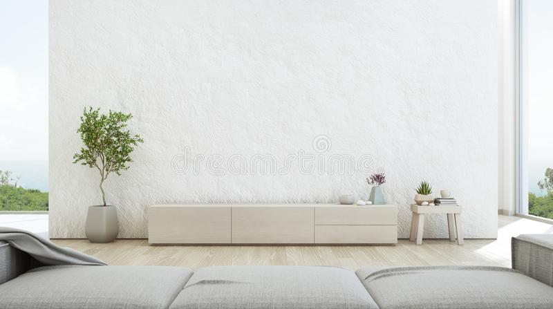 Sea view living room of luxury summer beach house with TV stand and wooden cabinet. stock photography