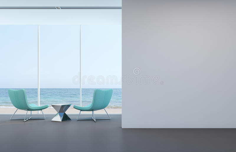 Sea view living room with white wall in modern house stock image