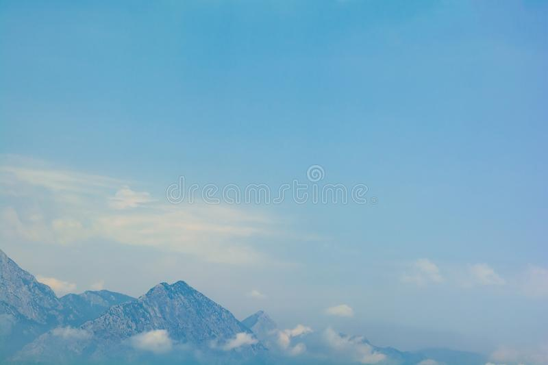 Sea view on peaks of Taurus Mountains covered by low clouds and fog from boat. Travel concept. Soft focus stock image