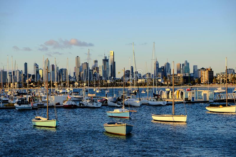 Boats and yachts at St Kilda Pier, Melbourne, Australia. Sea view of St Kilda pier where boats and small yacht can be seen. Far away at the back is the downtown royalty free stock photos