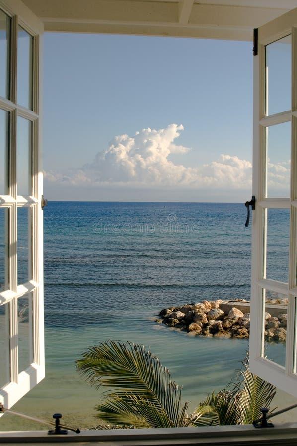 Sea view through window at the beach, Halfmoon Bay, Jamaica. Looking through a window at the beach stock image