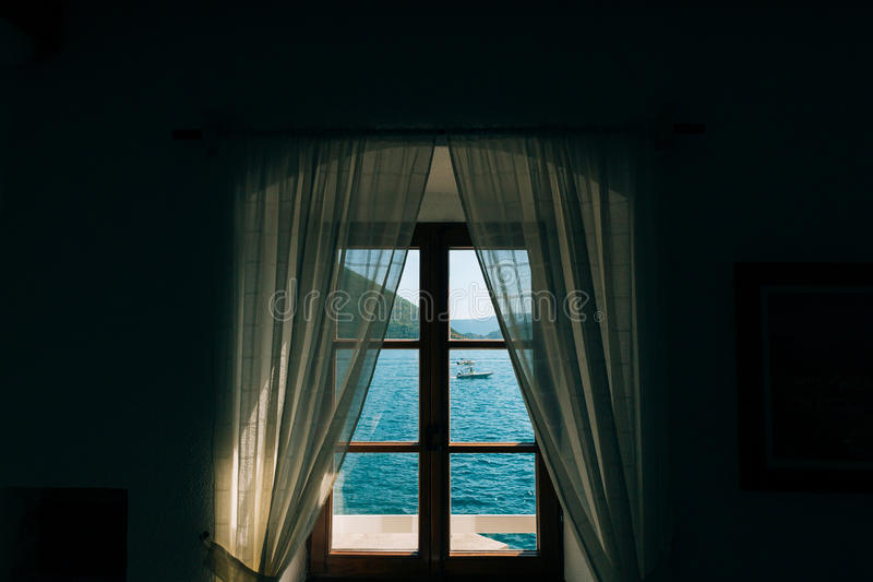 Sea view from the window stock photography