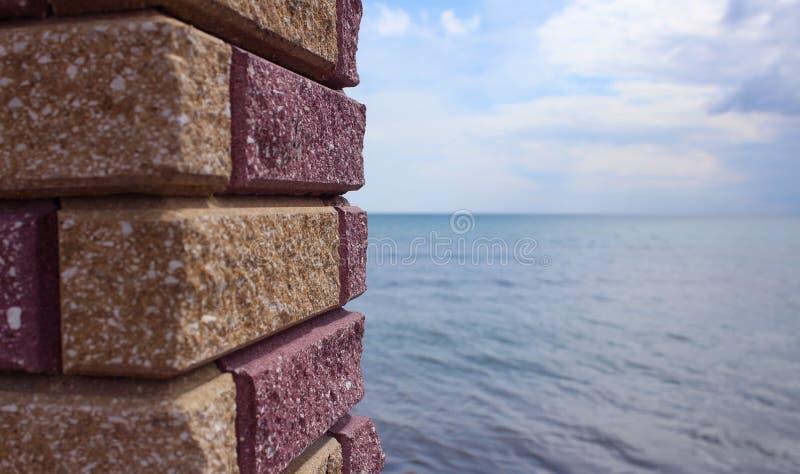 Sea viewed through window of stone wall. royalty free stock image