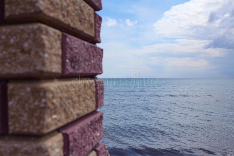 Sea viewed through window of stone wall. royalty free stock images