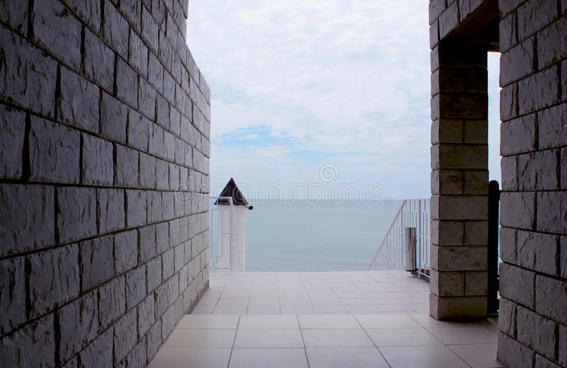 Sea viewed through window of stone wall. stock photography