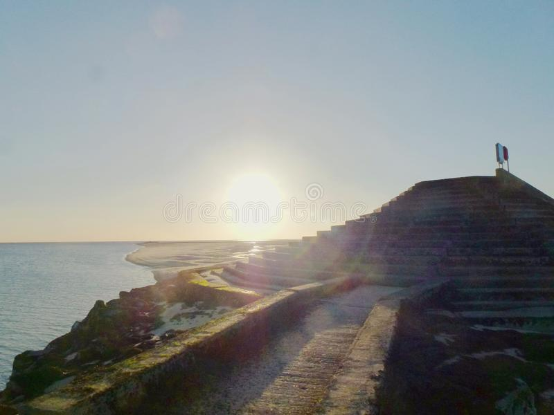 Sunset over the breakwater royalty free stock images