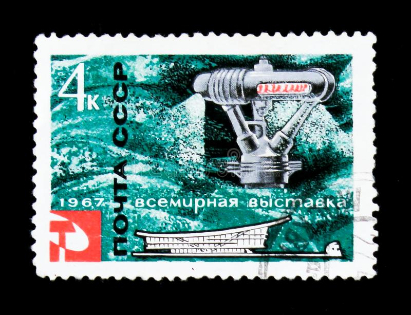 Sea water distilling apparatus, World exhibition in Montreal, circa 1967. MOSCOW, RUSSIA - JUNE 26, 2017: A stamp printed in USSR Russia shows sea water royalty free stock images