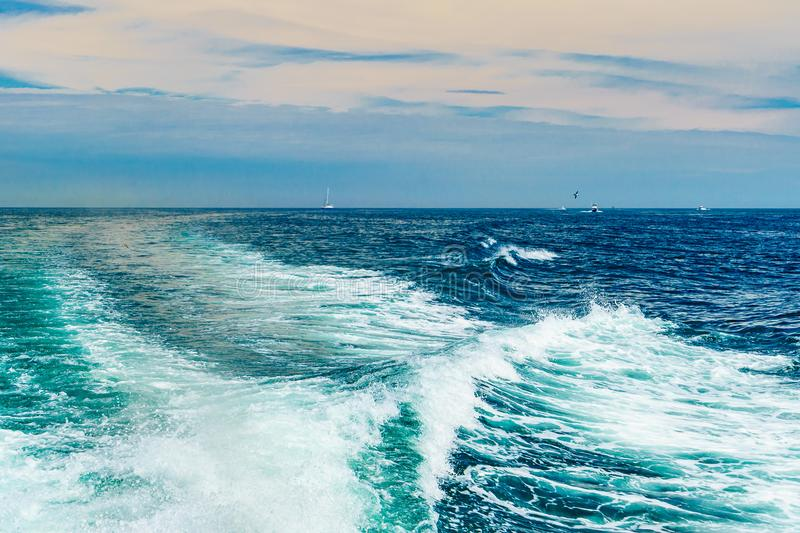 Sea water foam Ship track in the ocean Water texture. Ocean view Marine travel Cape cod Massachusetts. US royalty free stock images