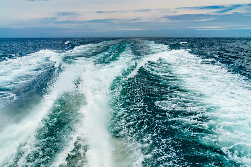 Sea water foam Ship track in the ocean Water texture. Ocean view Marine travel Cape cod Massachusetts. US royalty free stock photos