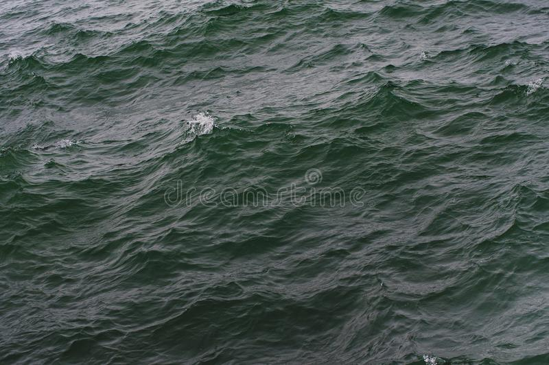 Sea water texture in the storm. Nature background royalty free stock photos