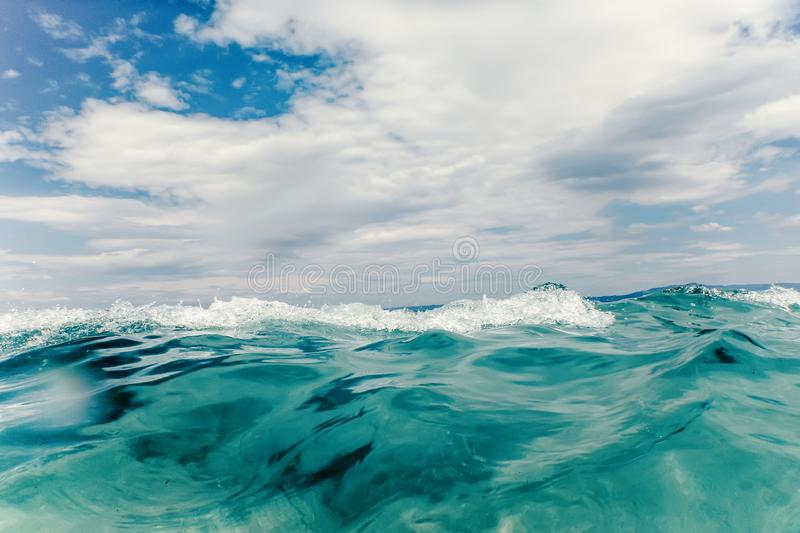 Sea wave close up, low angle view water background. Water surface royalty free stock image