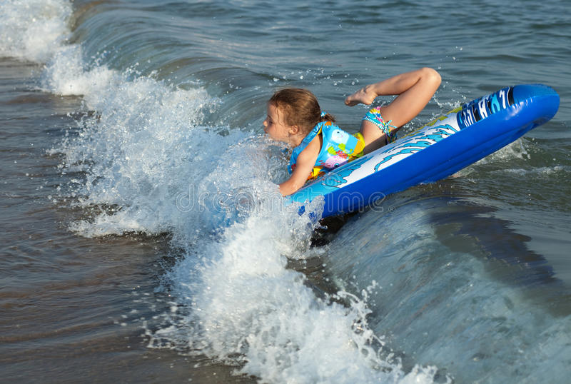 Sea wave flips the child. royalty free stock photos