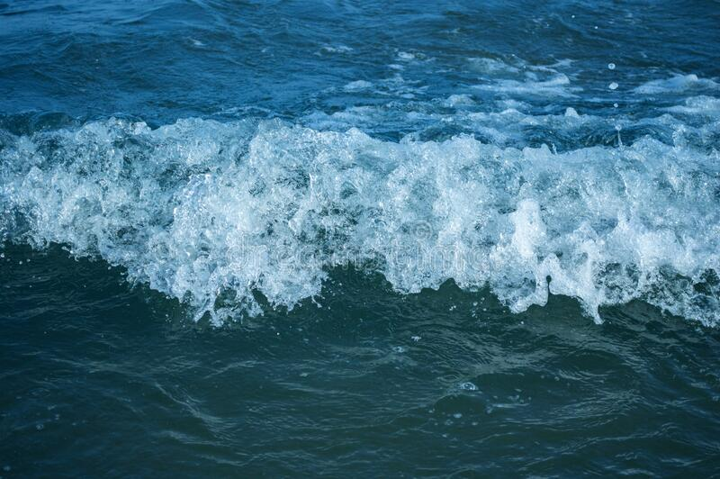 Sea wave with foam horizontal. In detail royalty free stock photos