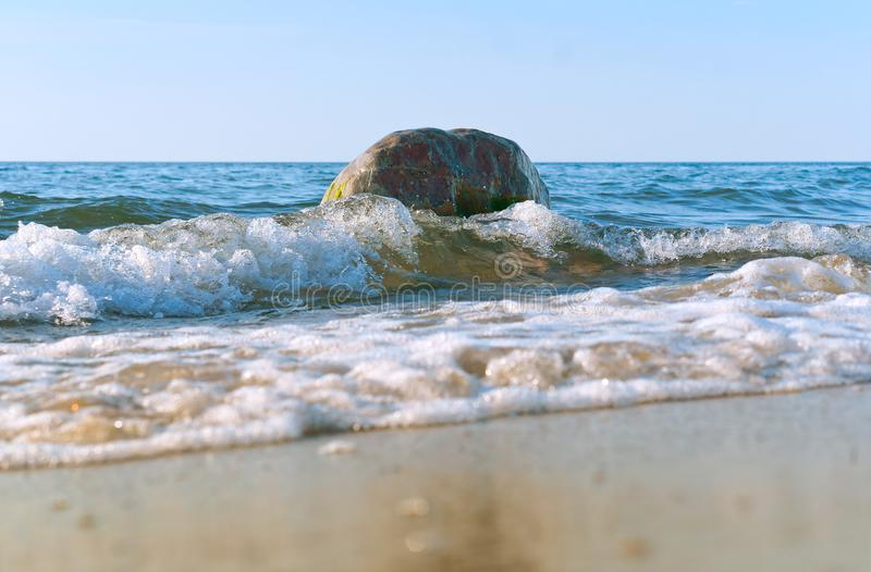 The waves break on the coastal rocks, the sea wave hits the shore royalty free stock images