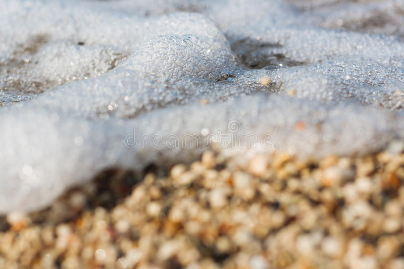 Sea wave rolling over the pebbles royalty free stock images