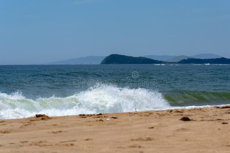 Sandy coast and blue sea. royalty free stock image
