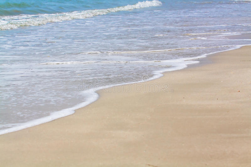 sea wave and sand royalty free stock photography