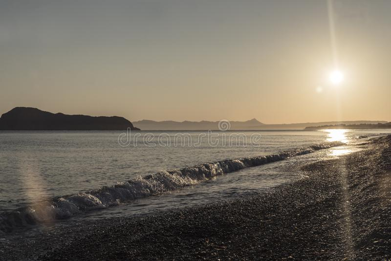 Sea wave and sun set on the coast of Crete royalty free stock images