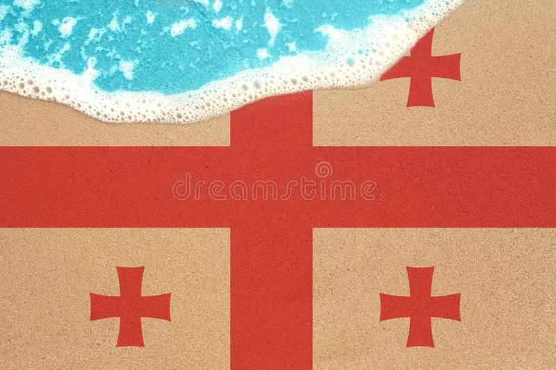 Sea wave on the sunny sandy beach with flag Georgia. View from top on surf royalty free illustration