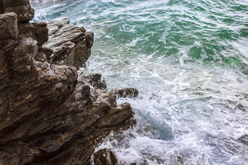 Sea waves against rocks stock photo