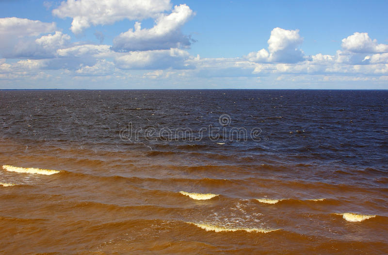 Sea waves on background of blue sky royalty free stock photo