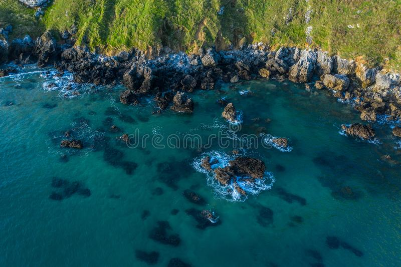 Sea waves breaking in the reefs and coast of Sonabia, Spain, Cantabrian sea. Drone aerial view stock images