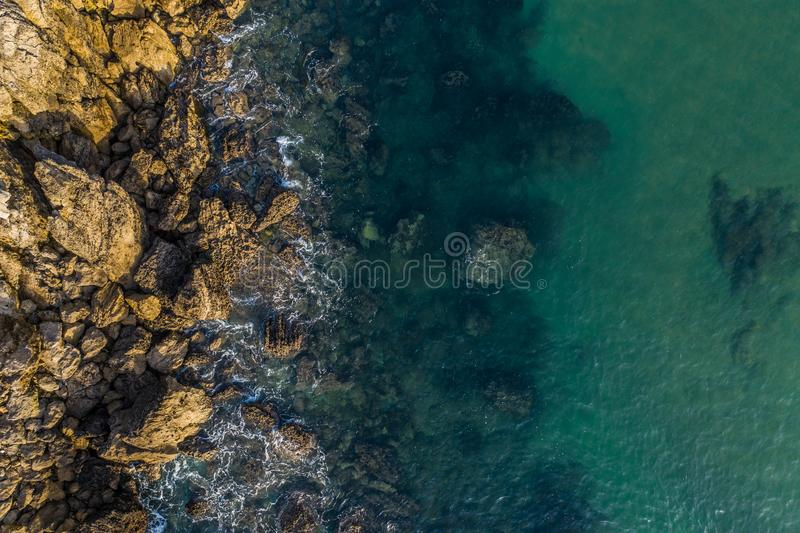 Sea waves breaking in the reefs and coast of Sonabia, Spain, Cantabrian sea. Drone aerial view stock photos