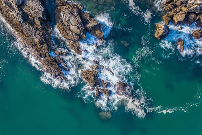 Sea waves breaking in the reefs and coast of Sonabia, Spain, Cantabrian sea - long exposure. Sea waves breaking in the reefs and coast of Sonabia, Spain stock photo