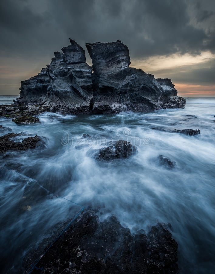 Sea waves cliff rock. Dramatic color stock image