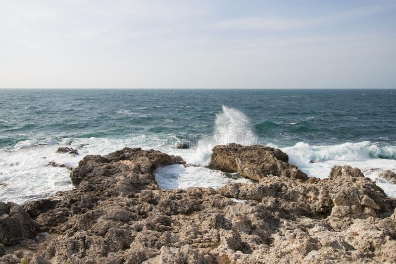 Sea waves crashing against the rocks. Day stock images