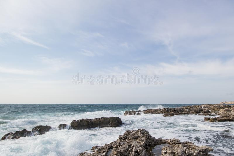 Sea waves crashing against the rocks. Day royalty free stock photos