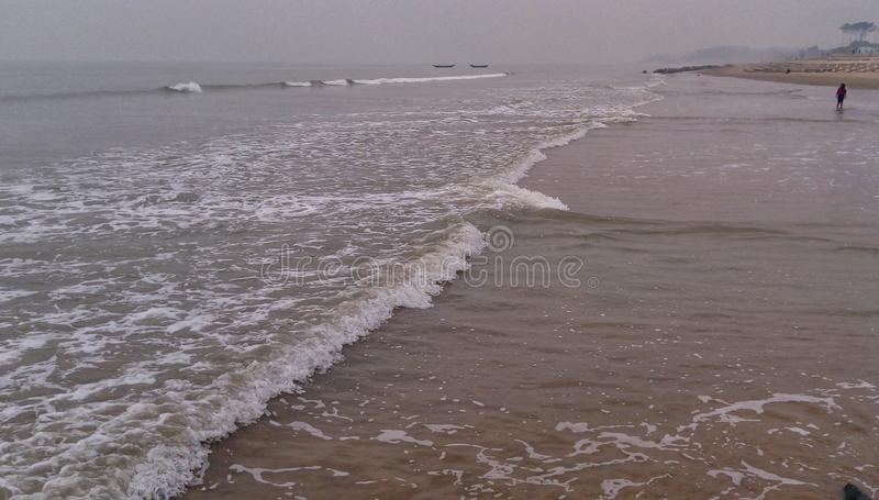 Sea waves are gradually approaching the coast. Tourist, tourism royalty free stock image