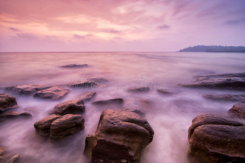 Sea waves lash impact rock. On the beach stock photos