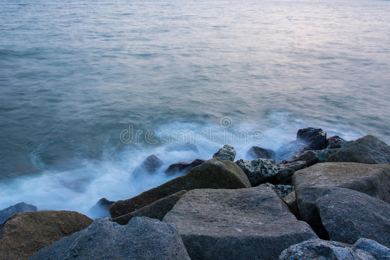 Sea waves lash line impact rock . royalty free stock photography
