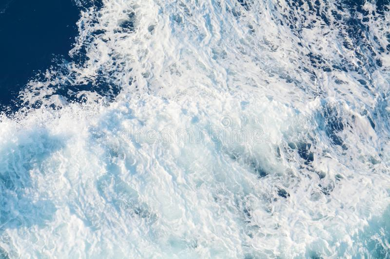 Blue waves backgound, sea landscape and white bubbles royalty free stock images