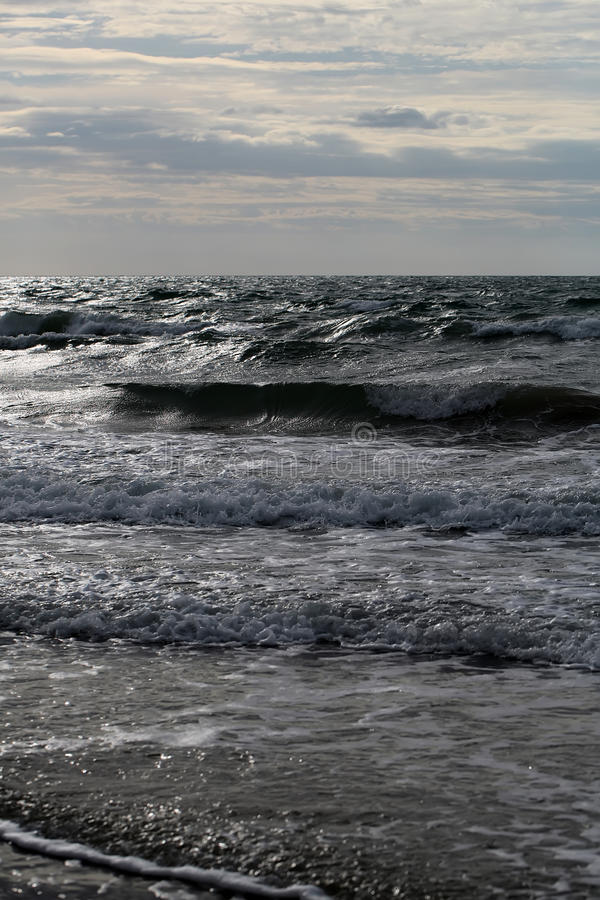 Sea waves on murky day stock image