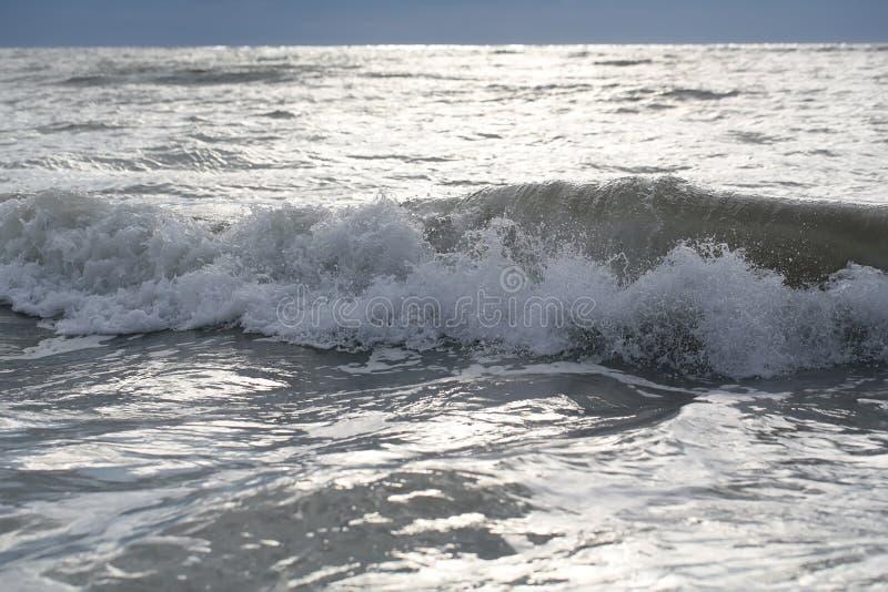 Sea waves on murky day stock photo