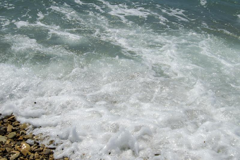 Sea waves on the summer beach. Water stock images