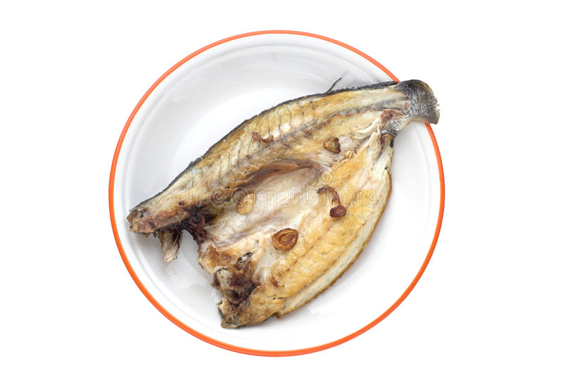 Seabass cooked. Seabass grilled with garlic royalty free stock images