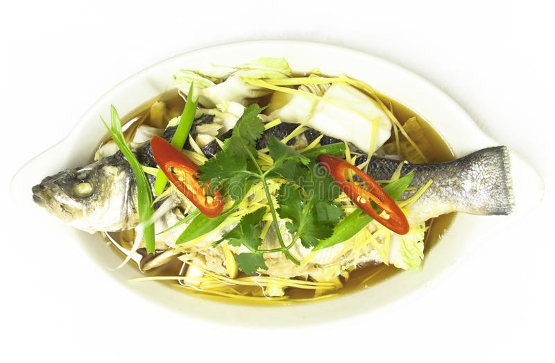 Seabass Nueng Khing. Steamed Fresh whole seabass with fresh ginger, onion and fresh chillies royalty free stock photos
