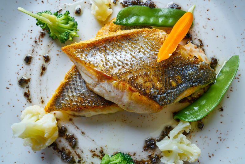 Seabass sea bass with stir fried vegetables. Recipe stock images