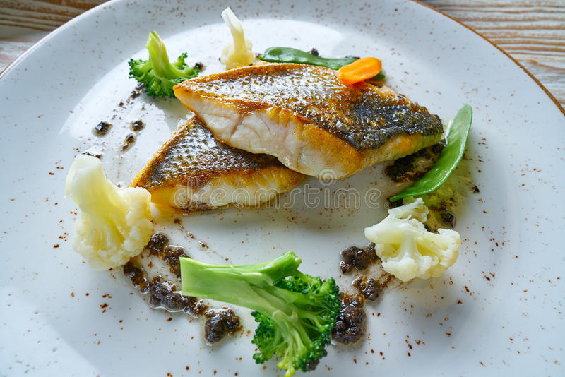 Seabass sea bass with stir fried vegetables. Recipe stock photography