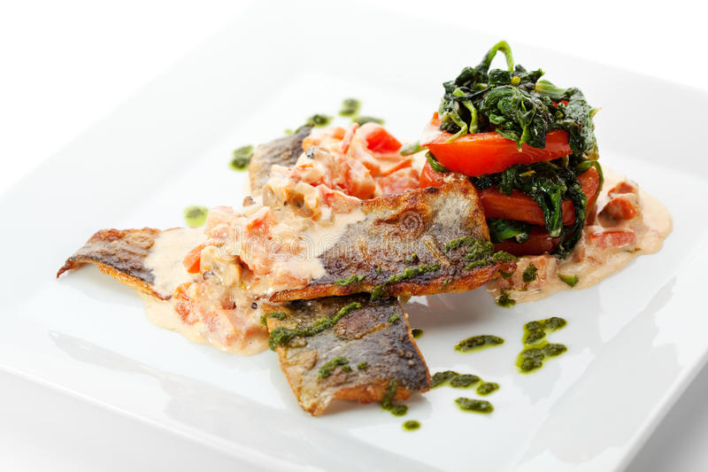 Seabass with Tomato. Fillet of Seabass with Tomato and Mussels Sauce royalty free stock photos